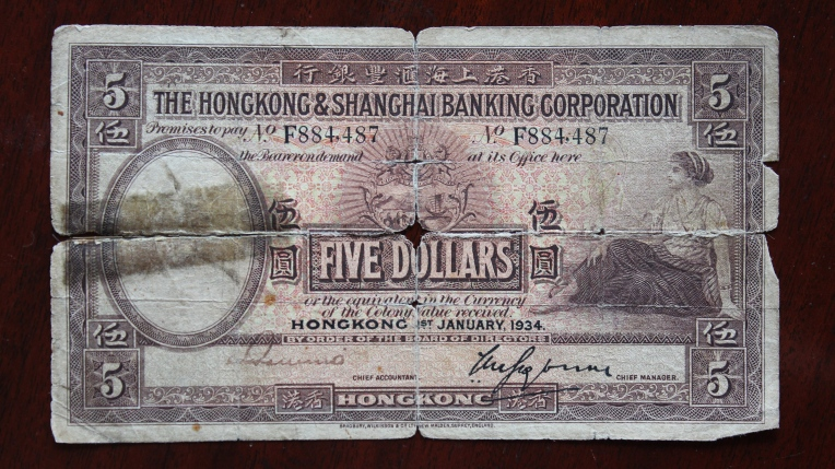Five dollars in Hongkong & Shanghai bank currency, issued January 1934. From Virginia's scrapbook. Photo by P.H. Wells